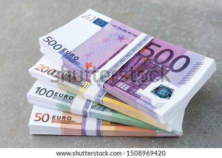 Euro currency money. Cash money, euro bills. Stacks of Euro notes on concrete background in five hundred, two hundreds, one hundreds and fifties