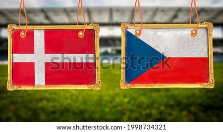 Euro 2021, Denmark vs Czech republic on hanging golden frame photo border  with blurred stadium background Foto stock ©