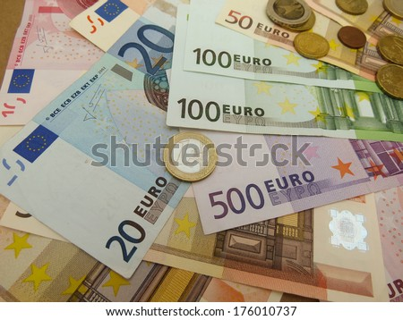 Euro (EUR) banknotes and coins money useful as a background or money concept
