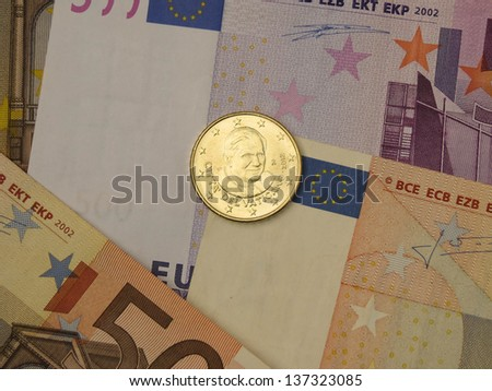 Euro (EUR) banknotes and coins money useful as a background or money concept - with a coin from Vatican (Pope Benedict XVI)