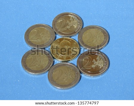 Euro (EUR) coins from Vatican useful as a background or money concept - 2 euro coin bearing a portrait of former Pope Benedict XVI surrounded by six 2-euro coins