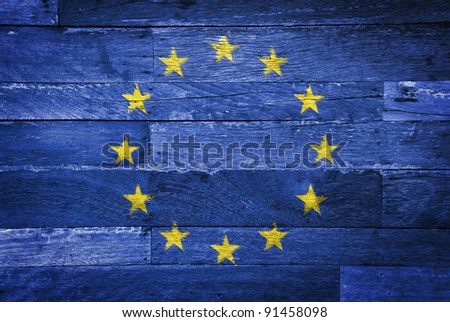 Euro flag painted on old wood background
