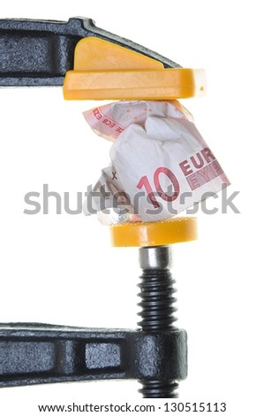 Euro in crisis, ten euro bill squeezed in a clamp isolated on white background