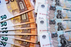 Euro money and rubles money banknotes