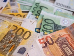 Euro Money Banknotes Photo Background. Two hundred euros, one hundred euros and fifty euros bills