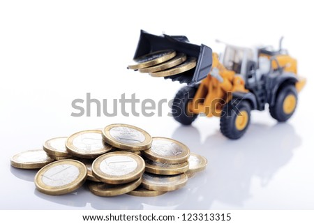 euro money coins and loader isolated on white background