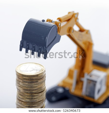 euro money coins with digger on white background