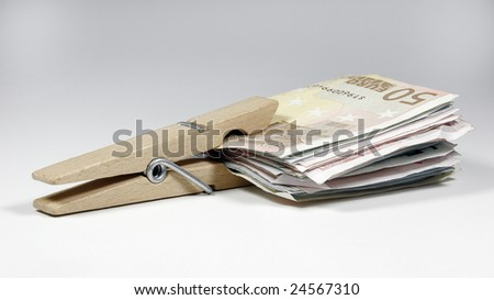 Euro money held from a clamp