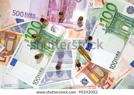 Euro money with bullets sign