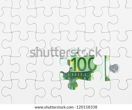 Euro note and jigsaw puzzle - stock photo