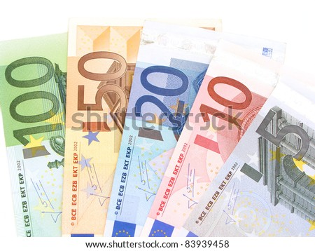 Euro notes arranged in a fan on a white background