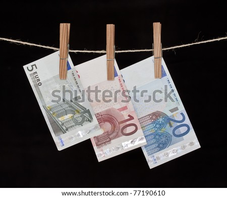 Euro notes hanging from a rope, See my portfolio for more