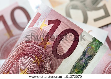 Euro notes in full-frame, with focus on front ten Euro note.