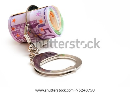 Euro notes with a pair of handcuffs