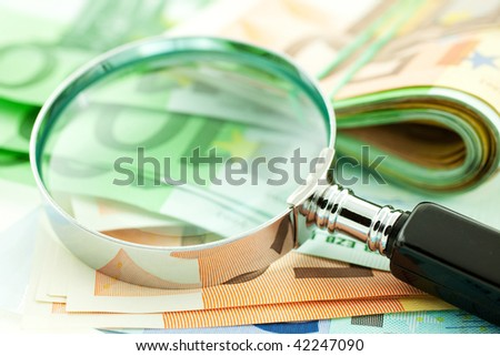 euro notes with magnifier. CloseUp. small GRIP