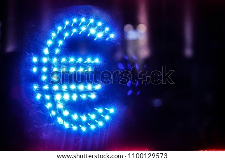 euro sign. signboard currency exchange.  board currency exchange in night blue light. #1100129573