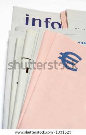 Euro symbol on Stacked newspapers a white background