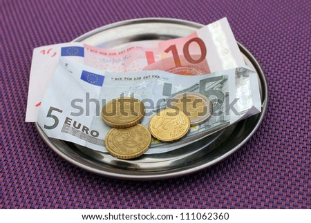 Euro tipsand payment for bill on on restaurant table. - stock photo