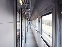 EuroCity Train wagon inside interior perspective Photo. No people. Empty train compartment with a row of closed doors. Comfortable sleeping train compartments. Czech Railways.