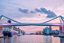 Europa Bridge at the entrance to Port Vell Barcelona, Catalunya Spain. Beautiful peaceful view sunset
