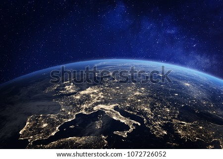 Photo of  Europe at night viewed from space with city lights showing human activity in Germany, France, Spain, Italy and other countries, 3d rendering of planet Earth, elements from NASA