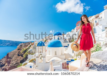 Europe cruise travel summer vacation luxury tourist destination Asian woman relaxing in Oia, Santorini, Greece. Popular european sightseeing landmark. Banner panorama.