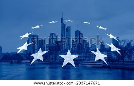 Europe flag - Skyline of Frankfurt at sunset -Frankfurt, Germany - Frankfurt is financial center of the Germany