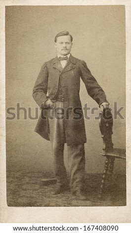 EUROPE - FRANCE - CIRCA 1860 - A vintage Cartes de visite photo of a middle aged gentleman. The man is standing  next to a chair. A photo from the Civil War era. CIRCA 1860