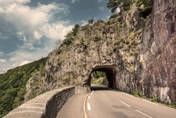 Europe, France, Col de la Schlucht: Road tunnel in famous French Vosges mountains - concept travel transport street traffic vacation nature rural rocky environment dramatic weather scenery landscape