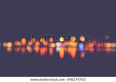 Europe, Greece, city night lights reflected in sea water, Mediterranean port, de focused. #698274763