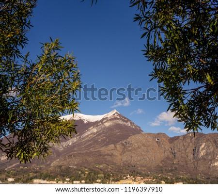 Europe, Italy, Bellagio, Lake Como, Cadenabbia, SCENIC VIEW OF MOUNTAINS AGAINST BLUE SKY #1196397910