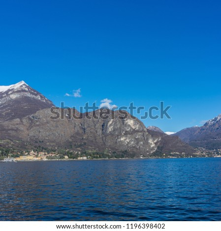 Europe, Italy, Bellagio, Lake Como, Cadenabbia, SCENIC VIEW OF SEA AND MOUNTAINS AGAINST CLEAR BLUE SKY #1196398402