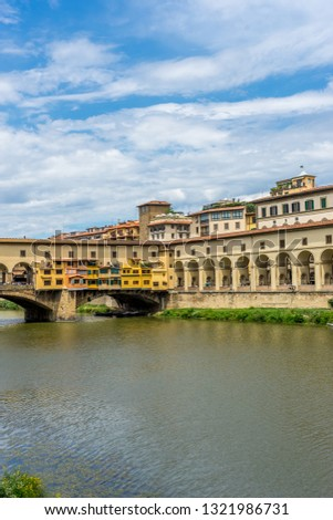 Europe, Italy, Florence, Arno, a large bridge over some water with Arno in the background