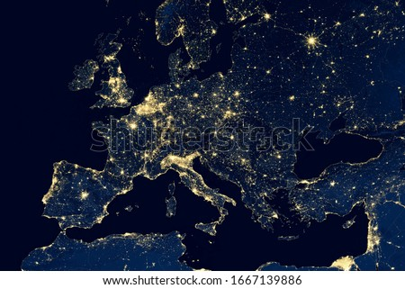 Europe map in global satellite photo, view of city lights on night Earth from space. EU and Mediterranean in world. Elements of this image furnished by NASA.
