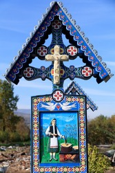 Europe, Romania. Sapanta, Merry (sometimes called Joy) Cemetery. Death is viewed more positively by a local wood carver, Stan Ioan Patras, who sculpted the first tombstone crosses.