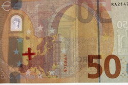 european bank note with a red cross on the map showing the eurpean union without great britain