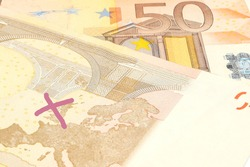 european bank note with a red cross on the map showing the eurpean union without great britain.