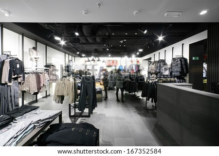 european clothing store interior in modern mall photo