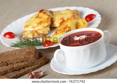 European cuisine. Soup and meat in French with fried potatoes