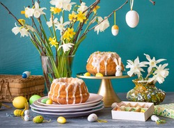 European Easter with traditional decoration eggs, daffodils and Easter cake