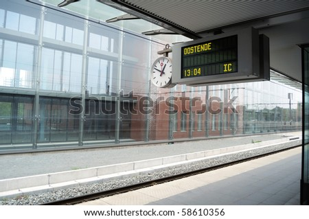 European empty train station platform with destination Oostende - stock photo