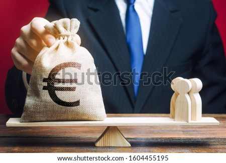 European euro EUR symbol on money bag and people on scales. concept attracting investment, business cooperation, crowdfunding startup. Solvency, taxpayers. Staff salary specialist services cost.