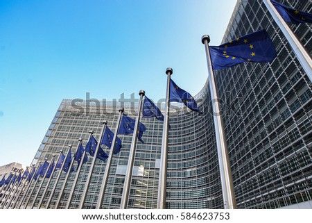 European flags on the background of the European Parliament #584623753
