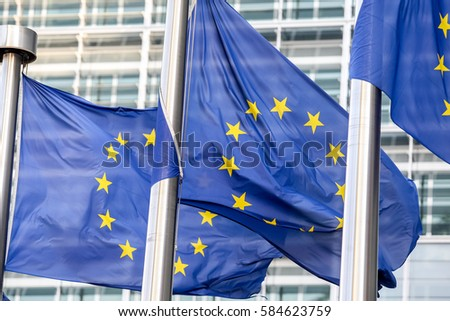 European flags on the background of the European Parliament #584623759