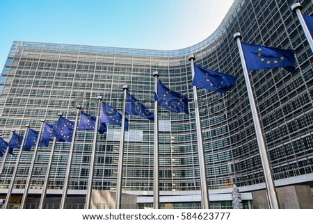European flags on the background of the European Parliament #584623777