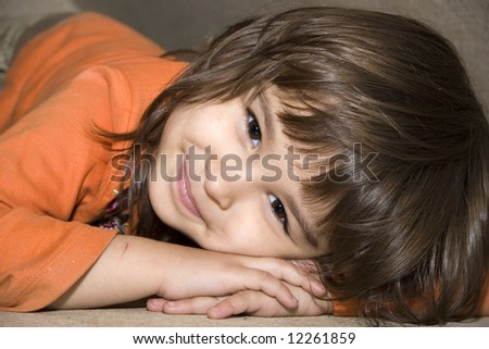 European four-year-old brown-eyed smiling girl Victoria (series Children)