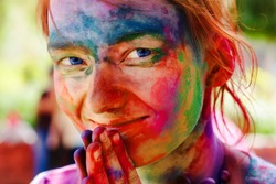 European girl celebrate festival Holi in Delhi, India. The main day, Holi, is celebrated by people throwing coloured powder and coloured water at each other.