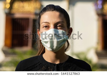 European girl tourist wearing a face mask during the crisis of the coronavirus in Thailand, Asia