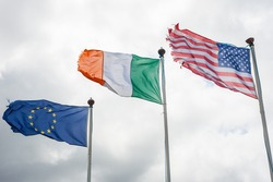 European, Irish and American flags blowing in the wind