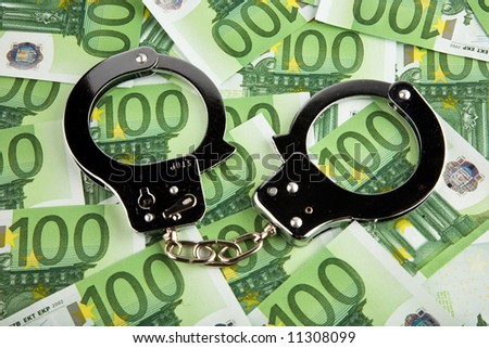 European money and handcuffs